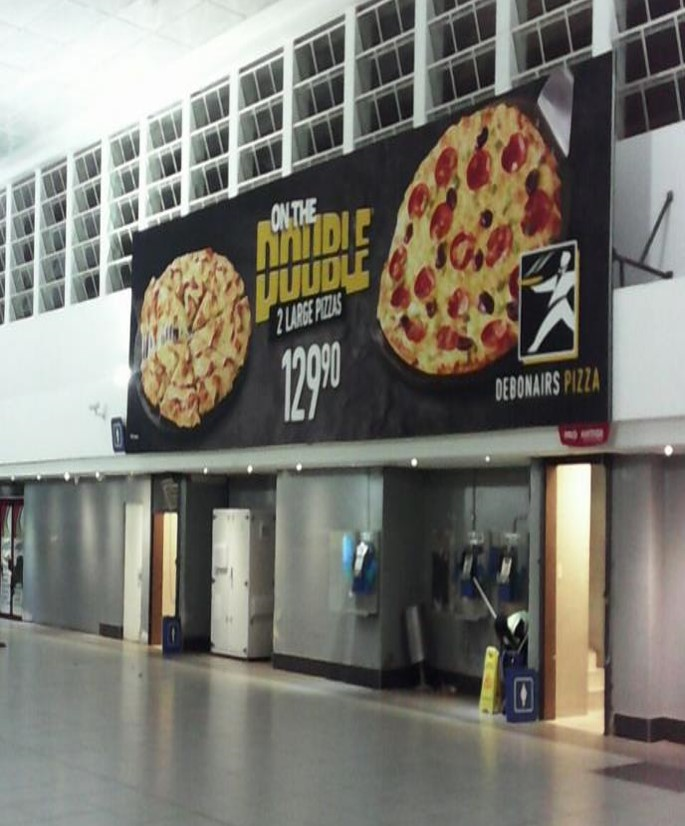 Transit Ads Train Station Branding Debonairs